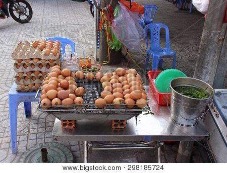 Grilled Eggs For Sale In Street Market In Vietnam. Traditional Local Cuisine Of Vietnam.