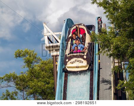 Jackson, New Jersey - June 30: A Family Enjoys A Log Flume Ride At Six Flags Great Adventure On June