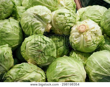 Fresh Cabbage At The Supermarket Kiosk. Fresh Cabbage On Display In The Grocery Store. Cabbage On Th