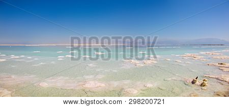 Panoramic View Of The Stunning Blues And Stark White Salt Piles Dotting The Dead Sea