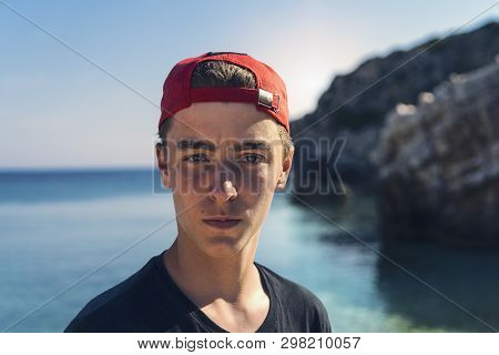 Portrait Of A Young Man Standing In Front Of The Ocean