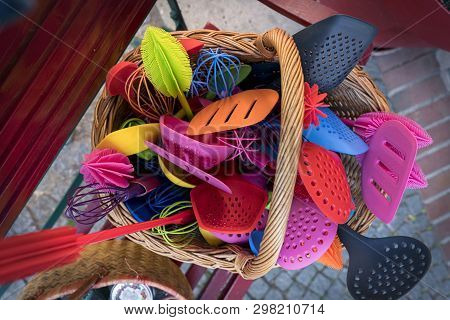 Many Colorful Plastic Kitchen Tools In A Basket