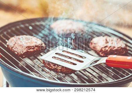 Delicious vegetarian burger grilled on bbq, macrobiotic rissole on the grill for veggie burger, spring weekend picnic outdoors, tasty and healthy organic nutrition
