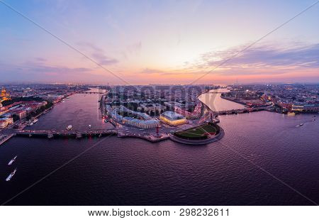 Beautiful aerial evning view in the white nights of St. Petersburg, Russia, The Vasilievskiy Island at sunset, Rostral Columns, Admiralty, Palace Bridge, Stock Exchange Building. shot from drone. poster