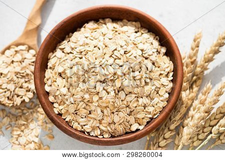 Oats, Oat Flakes Or Rolled Oats In A Bowl. Closeup View. Healthy Clean Eating Food, Healthy Lifestyl