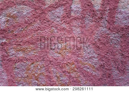 Pink Granular Concrete Wall With White Spots Of Paint. Rough Surface Texture
