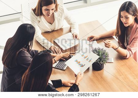 Businesswomen In Meeting, Laptop Computer On Table