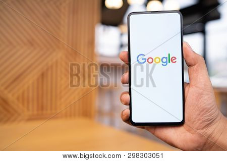 Chiang Mai, Thailand - Mar. 23,2019: Man Holding Xiaomi Mi Mix 3 With Google Search On Screen. Googl
