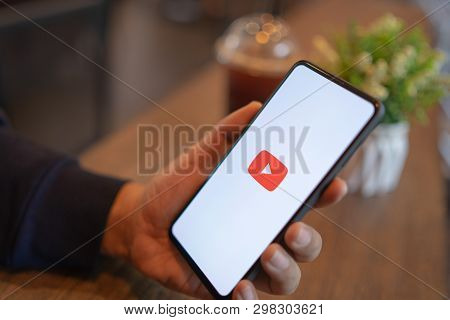 Chiang Mai, Thailand - Mar. 24,2019: Man Holding Xiaomi Mi Mix 3 With Youtube Apps On Screen. Youtub