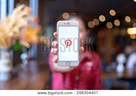 Chiang Mai, Thailand - Apr.08,2019: Woman Holding Apple Iphone 6s Rose Gold With Pinterest Apps Logi