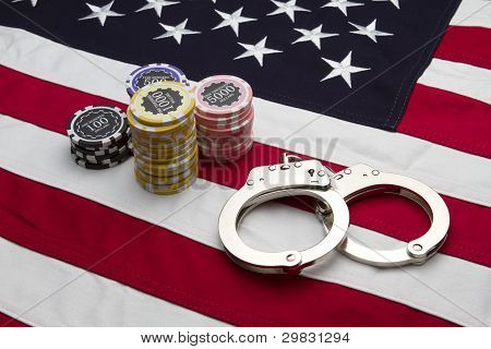 US Flag with poker chips and handcuffs
