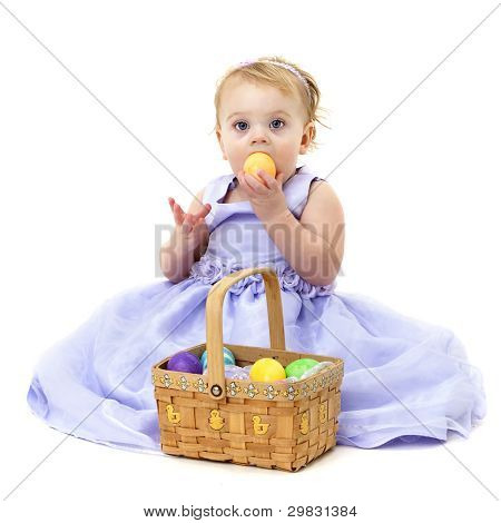 baby girl with Easter basket and eggs