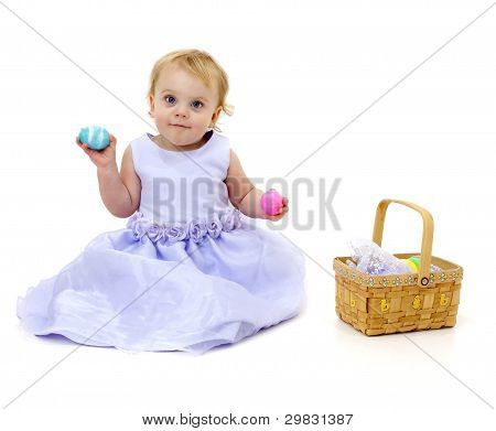 pretty baby with Easter eggs