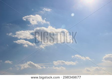 Many Blue Sky With Small Clouds In The Sun Rays, Boke. Breathing In The Fresh Air, You Feel The Appr