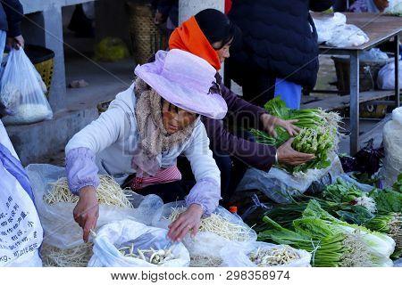 Shaxi, Yunnan, China - November, 2018. A Vegetable Stand In The Village Market Of Shaxi, Yunnan, Chi