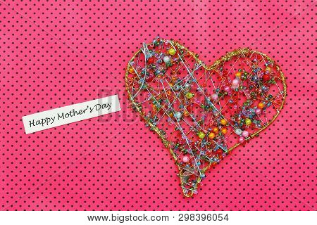 Happy Mothers Day Card With Heart Made Of Colorful Beads On Pink Dotty Background