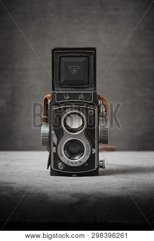 A Seagull 4 Tlr Twin Lens Reflex Camera With Brown Strap On A Grey Background, Nottingham, Uk - Janu