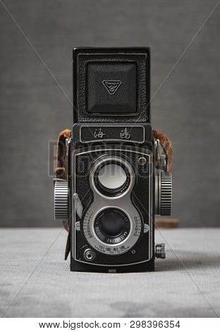 A Seagull 4 Tlr Twin Lens Reflex Camera With Brown Strap With A Grey Background, Nottingham, Uk - Ja