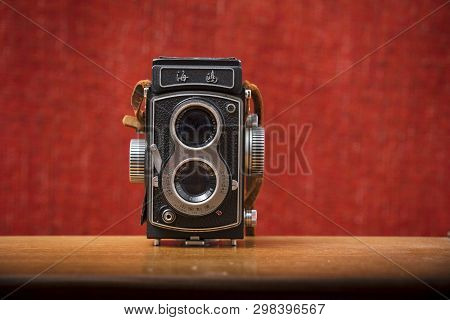 A Seagull 4 Tlr Twin Lens Reflex Camera With Brown Strap On A Red Background, Nottingham, Uk - Janua