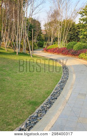 Beautiful summer garden with a walkway winding its way through, Silver birch and shrub and flowerbed around. Fuzhou,China