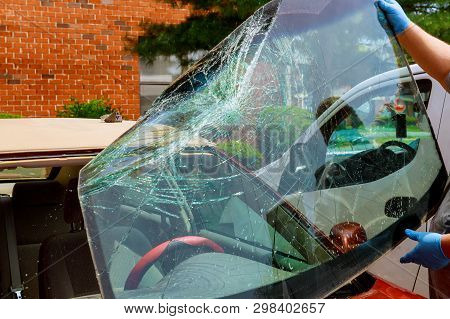 Broken Windshield Car Special Workers Take Of Windshield Of A Car In Auto Service From Inside From A