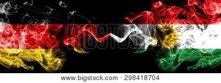 Germany Vs Kurdistan, Kurdish Smoky Mystic Flags Placed Side By Side. Thick Colored Silky Smoke Flag