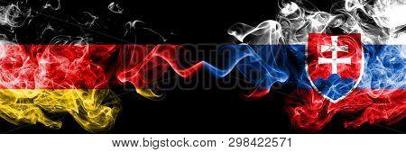 Germany Vs Slovakia, Slovakian Smoky Mystic Flags Placed Side By Side. Thick Colored Silky Smoke Fla