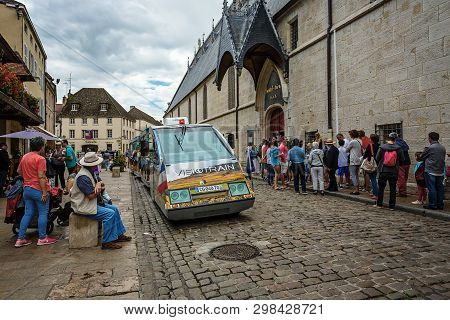 Beaune, France - August 10, 2017: Excursion Car In The City Of Beaune Near The Famous Building Hotel