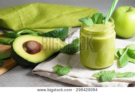Avocado Spinach And Green Apple Smoothie Healthy And Refreshing Tropical Drink Front View Of A Glass