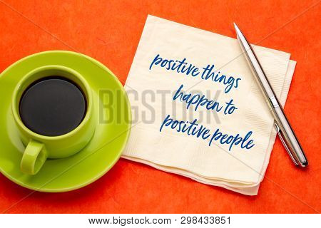 positive things happen to positive people - handwriting on a napkin with a cup of coffee, law of attraction concept