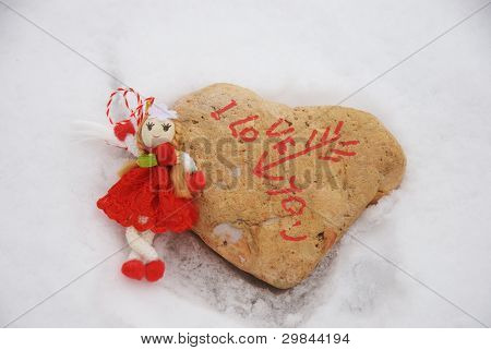 Martisor with stone heart on the snow