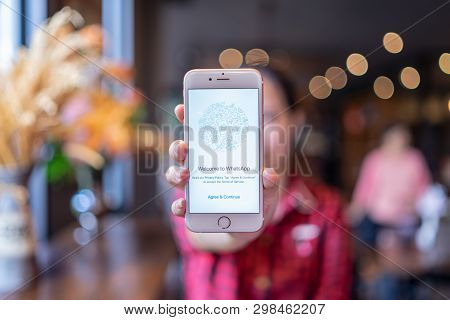 Chiang Mai, Thailand - Apr.08,2019: Woman Holding Apple Iphone 6s With Whatsapp Messenger On The Scr