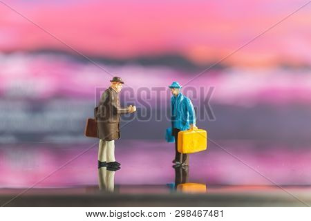 Tourist Handshake With Friend On Colorfull Background