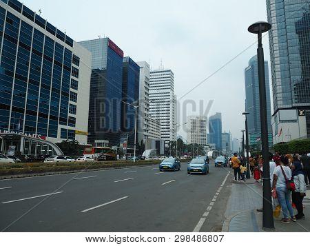 Jakarta, Indonesia - April 7, 2019: Crowd Of People Walking On The Pavement Of Jalan Thamrin (thamri