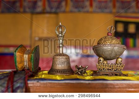 Buddhist religious equipment - Vajra Dorje and bell. Closeup of the ceremonial objects in tibetan buddhist monastery in Ladakh