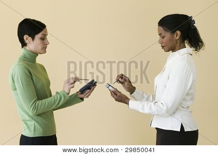 Businesswomen with palm pilot