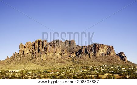 The Superstition Mountains in Apache Junction, Arizona, USA on a bright, clear day poster