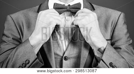 esthete. stylish art director. businessman fix bow tie. illusionist. Bride groom ready for wedding. business man in formal suit. PR manager make his style. Tying a bow tie. Close-up on nerd poster