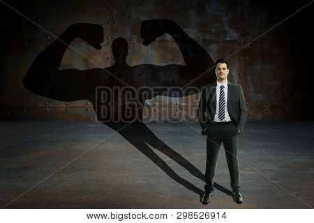 Young And Handsome Businessman With Secret Powers. Business Motivation And Succes Concept.