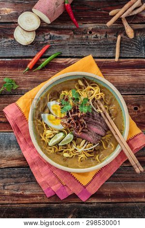 Bowl Of Spicy Mee Rebus With Chopsticks, Malaysian Cuisine