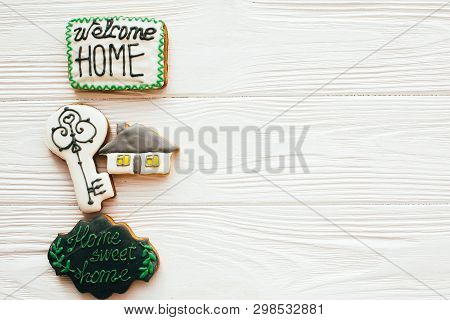 Moving In New House, Welcome Home Set. Key, House, Welcome Sign Cookies On White Wood, Flat Lay With