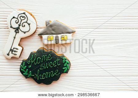Key, House, Welcome Sign Cookies On White Wood, Flat Lay With Space For Text. Dream Home Concept. Ho