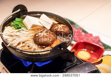 Japanese Sukiyaki Hot Pot With Vegetable, Beef Slice, Raw Egg