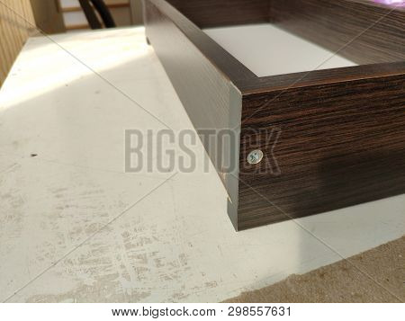 Closeup Of Woodwork And Furniture Making Concept. Carpenter In The Workshop Marks Out The Details Of