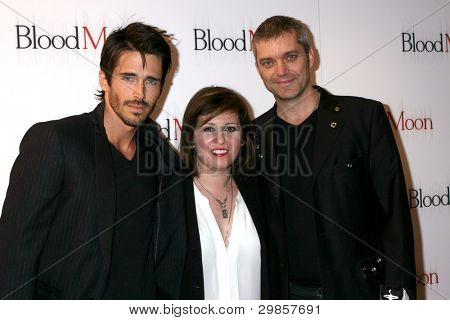 LOS ANGELES - FEB 9:  Brandon Beemer, Farnaz Saminia, Gil Darnell arrives at the