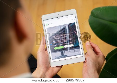 Td Ameritrade Website On A Tablet And Businessman Trader Holding Bitcoin.