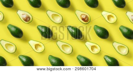 Avocado Pattern On Yellow Background. Pop Art Design, Creative Summer Food Concept. Green Avocadoes,