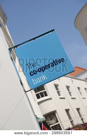 Co-operative Bank Sign On The High Street In The Town Of St Pierre Port (st Peter Port), The Main Se