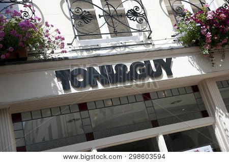 A Toni & Guy Hairdressers Sign On The High Street In The Town Of St Pierre Port (st Peter Port), The