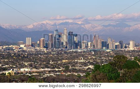 Panoramic View Of The City Of Los Angeles California With Snowy Mountain Caps Showing The End Of The